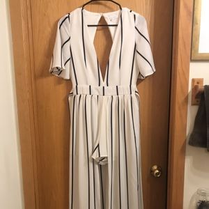 Black and white strip romper with dress overlay.